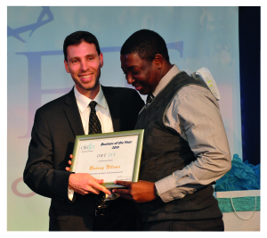 Paul Bacher at the Eureka Awards Evening 2013 with the Business of the Year winner Rodney Ntlemo