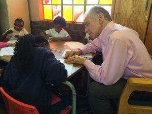 Mr Barry Judelman observing first hand how students problem solve