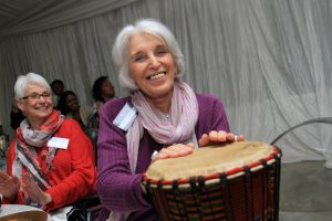 World ORT members Ms Reese Feldman and Judy Menikoff, Chairman for the Development and Allocations Commitee enjoying joining in with the drumming