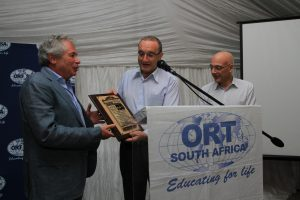 Brian Joffe, Bidvest CEO and ORT SA President being presented an award by Shmuel SIsso, Director General & CEO World ORT as well as Dr Jean De Gunzburg, Chairman of the Board of Trustees World ORT