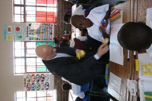 Dr Jean De Gunzburg handing out treats for the students