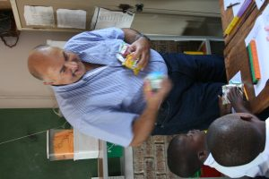 Peter Klauber, Chairman of the Finance Committee taking part in handing out the food and drinks to the students