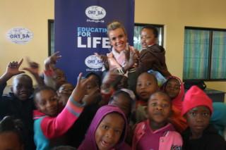 Bernadette with the children enjoying the programme