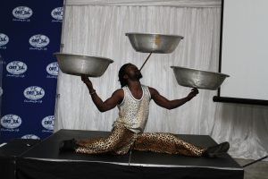 Acrobatic and balancing act performed by one of the drummers entertaining the audience